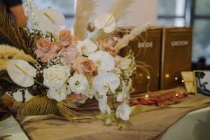 dried leaves and dusty pink flowers boho wedding